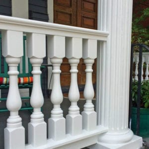 Victorian porch spindles and cedar railing with fluted columns
