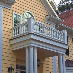 Covered entry with baluster railings