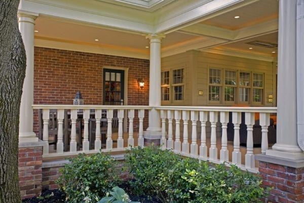 Classic spindles on covered patio railing