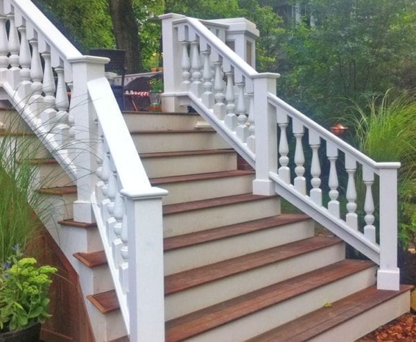 Stairs to deck with large cedar railings