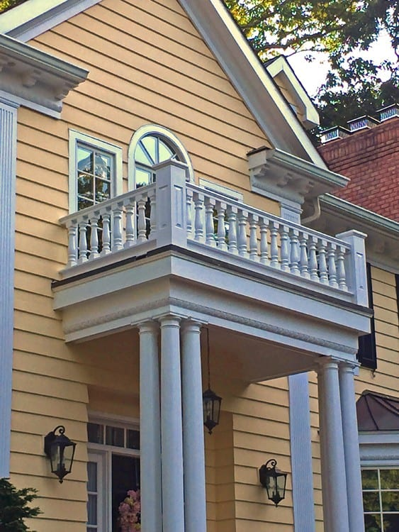 Covered entry with railings and columns