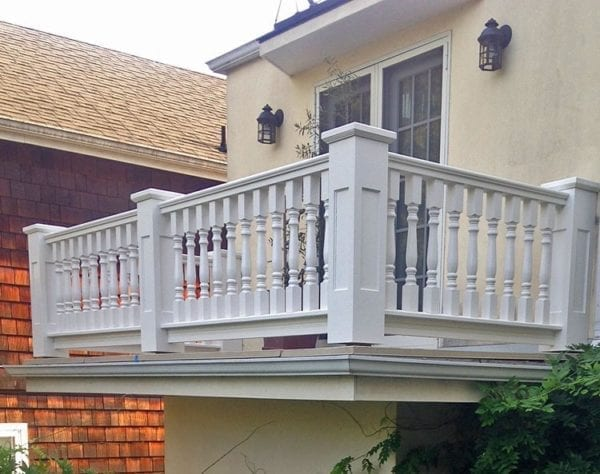 Classic balcony spindles and recessed panel newel posts and caps