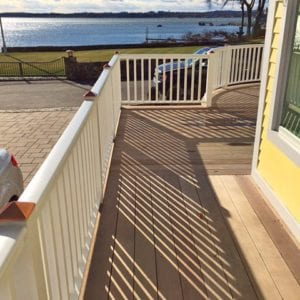 Deck railing in MA featuring square balusters