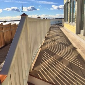 Deck railing with square balusters and sloped bottom rail