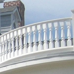 Tuscan porch railing spindles and curved rail