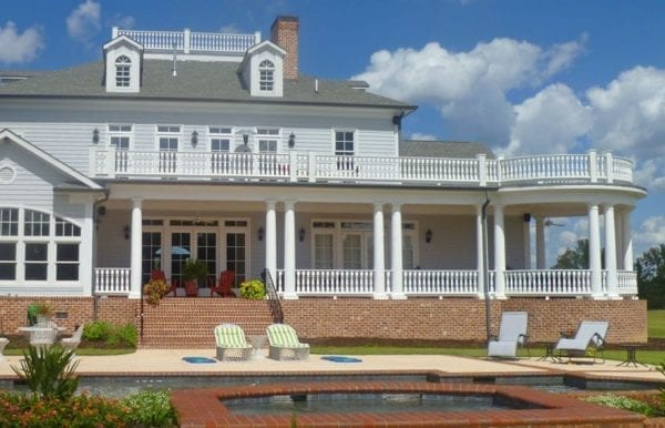 Tuscan porch spindles, raised panel newel posts, and columns
