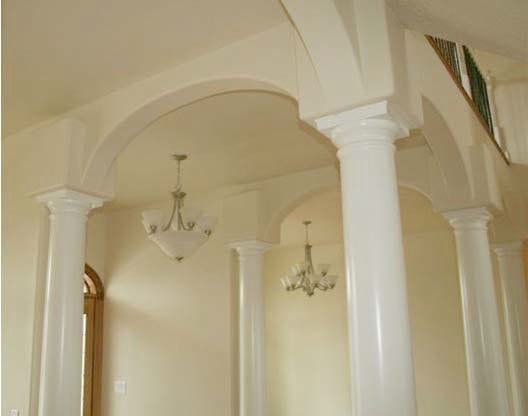 Interior round tapered column capitals