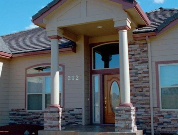 Covered entry with round tapered columns