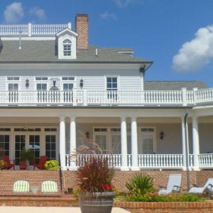 Two-story Porch with Victorian Porch Balusters and Curved Rail